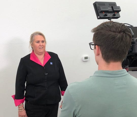 Sue Linder-Linsley, assistant manager with the Dallas Regional Census Center Field Division, speaks with a television reporter in Tyler, Texas Oct. 10.
