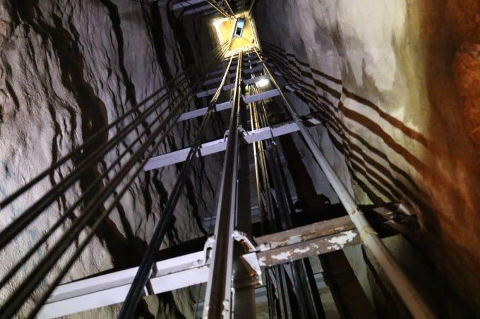 An elevator car descends down a 750-foot elevator shaft, Oct. 11, 2019 at Carlsbad Caverns National Park.