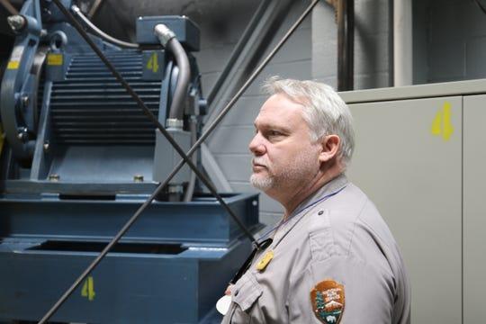 Carlsbad Caverns National Park Superintendent Doug Neighbor inspects the elevator system, Oct. 11, 2019 at Carlsbad Caverns.