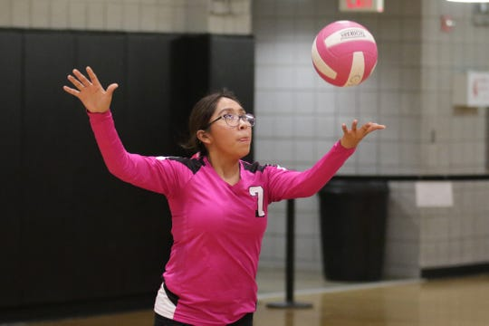 Navajo Prep's Britney Redhouse serves the ball against Thoreau during Thursday's District 1-3A volleyball match at the Eagles Nest in Farmington.