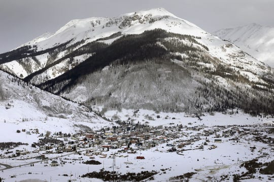 The town of Silverton is visible in December 2014 from U.S. Highway 550 in Colorado. Officials from the U.S. Environmental Protection Agency say the Silver Wing Mine near Silverton spilled wastewater into the Animas River earlier this week.