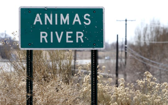 An Animas River sign is shown on Monday, Feb. 17, 2014, on Highway 550, north of Aztec.