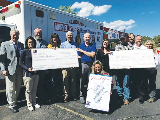 Showing their gratitude for the $100,000 are from left, Dr. D. Ryan Carstens, ENMU-Ruidoso president; Leslie Graham, foundation board member;  Harlan Vincent, First Responder Program Coordinator; Leslie Sisk, foundation board secretary/treasurer; Dr. Lynn Willard, foundation board president; Dr. Clayton Alred, foundation board member; Michelle Schmidt, EMT student; Captain Cameron Sidwell, RFD; Village of Ruidoso Fire Chief Cody Thetford, RFD; Rhonda Vincent, executive director, ENMU-Ruidoso Foundation; Ryan Trosper, ENMU-Ruidoso vice president of Student Success and Learning; and Coda Omness, director of Community Development and Career Technical Education Department chair. Not shown are foundation board members Sandy Gladden and J. Brady Barham.
