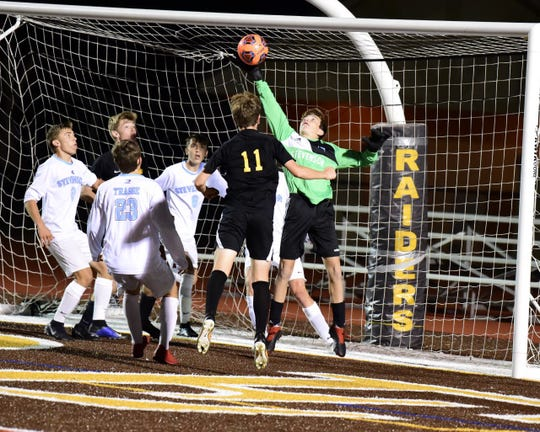 Stevenson sophomore goalkeeper Eric Fifer records a save. Livonia Stevenson defeated North Farmington 2-0 on Oct. 10.