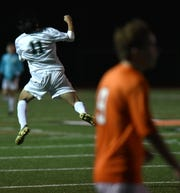 Novi Wildcat Shion Soga leaps into the air and pumps his fist to celebrate his first goal, and Novi's second, of the first half.