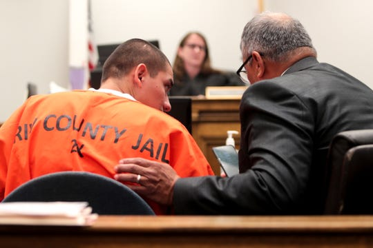 Anthony Torres speaks with his attorney on Wednesday, October 9, 2019 at Indio Juvenile Courthouse in Indio, Calif.