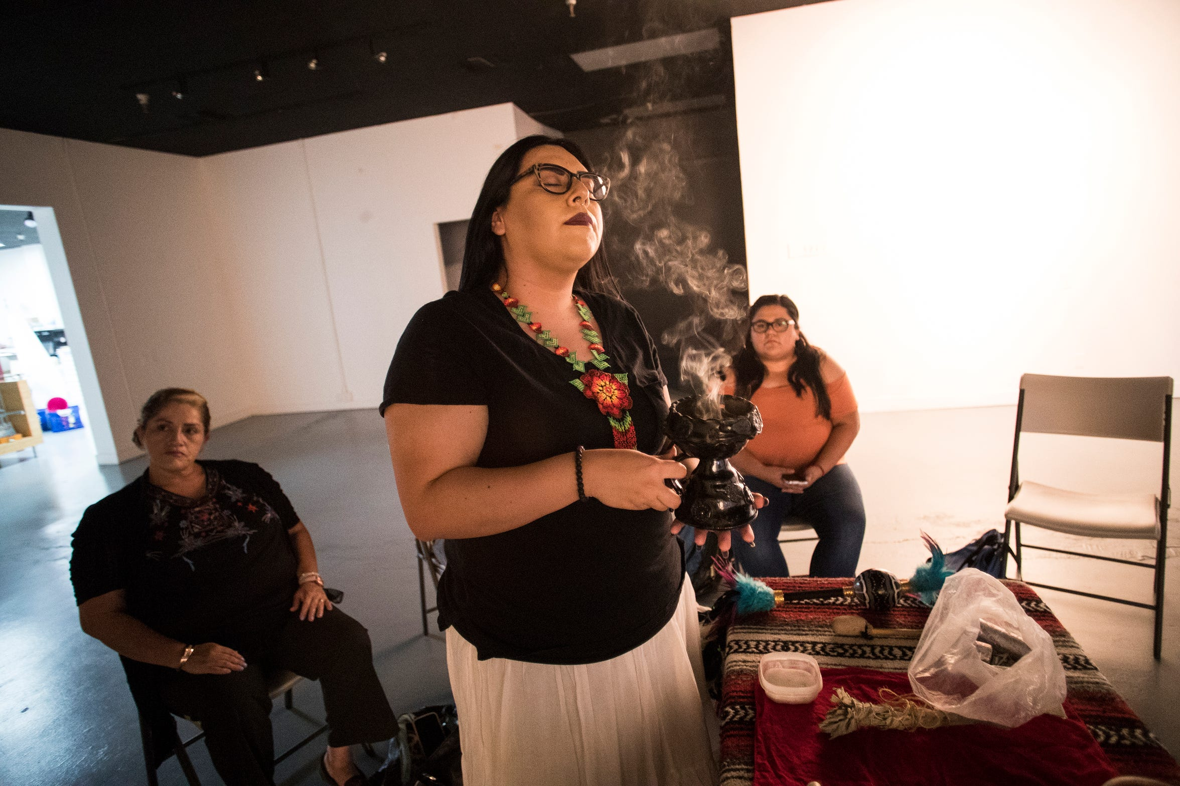 Claudia Armenta uses copal to cleanse herself during a healing circle.