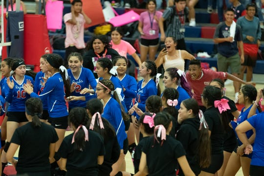 Indio High School Students rush the court to celebrate their win.