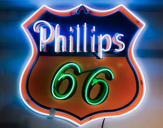 Automobilia such as the neon Phillips 66 sign is a touchstone of man caves everywhere.
