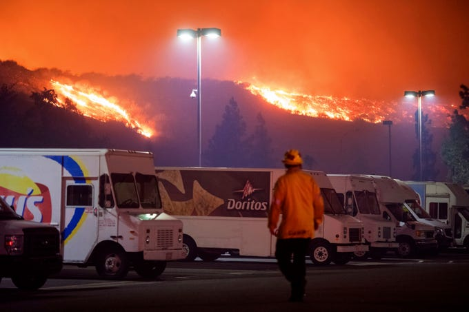 The Saddleridge fire burns near a Frito-Lay distribution plant in Sylmar, Calif., Thursday, Oct. 10, 2019.