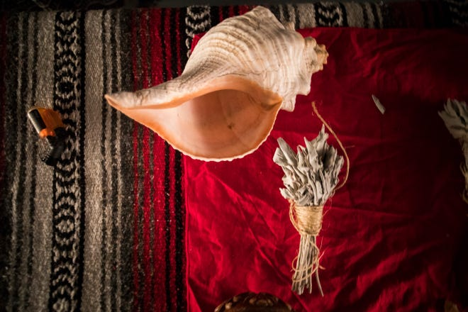 The conch is used during a healing circle.
