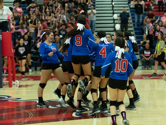 The Indio High School volleyball team celebrates a moment in their match against Coachella Valley on Oct. 10, 2019,