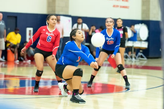 Martha Montejano of Indio goes low to return the ball against Coachella Valley.