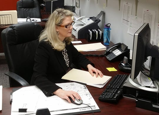 Rhonda White, a community corrections pre-trial diversion staff member, works on a case file at the Escambia County Department of Corrections.