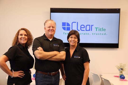 From left, Pennye Putman, chief operating officer of Clear Title of Northwest Florida, CEO Steve Moorhead and Karen Way, a closer, pose for a photo.