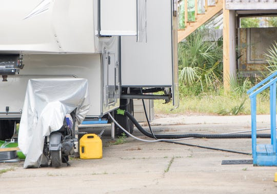 A camper is parked outside of a home in Navarre Beach on Friday.