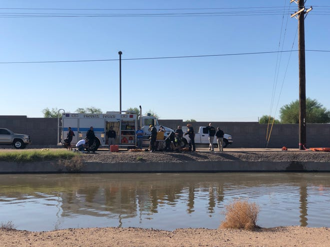 Phoenix authorities investigate a body found in a canal on Oct. 11, 2019, near Metrocenter Mall.