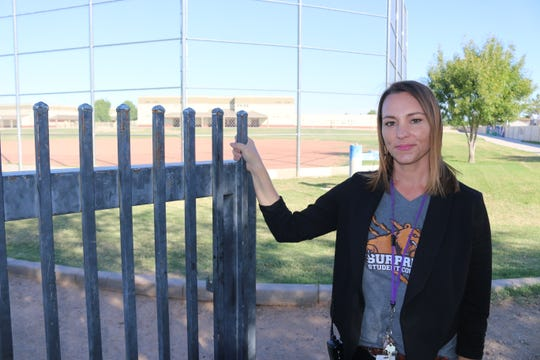 Surprise Elementary School Principal Karie Burns stands at the back gate of the school, the way many children get to school.
