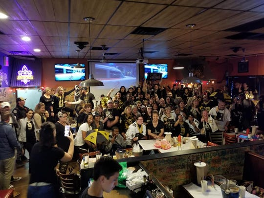 New Orleans Saints fans gather for a viewing party at The Angry Crab.