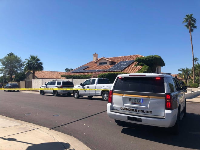 Police investigate a homicide at a home in the 6900 block of West Utopia Road on Oct. 11, 2019.