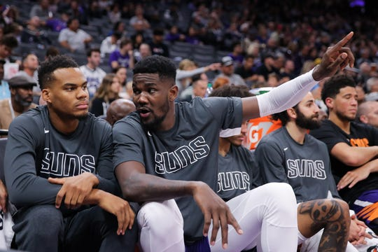 Oct 10, 2019; Sacramento, CA, USA; Phoenix Suns center Deandre Ayton (22) talks with teammates on the bench during the third quarter against the Sacramento Kings at Golden 1 Center. Mandatory Credit: Sergio Estrada-USA TODAY Sports