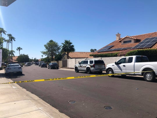Police were searching for the shooter who killed a man at a home in the 6900 block of West Utopia Road on Friday, October 11, 2019.