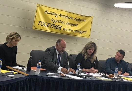Gary Messinger, Jr., center, at his first board meeting in October. Board Director Amy Sell is to his left.