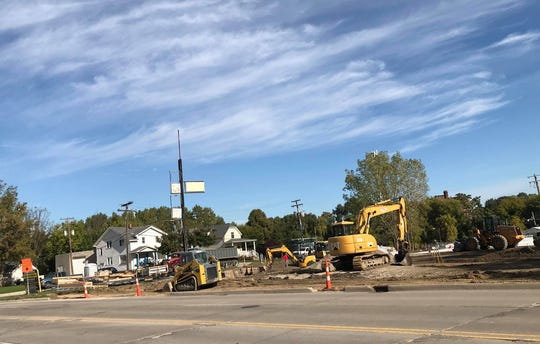 A construction crew works on the site of a new Dollar General at 1251 Water St. in Port Huron on Oct. 10, 2019.