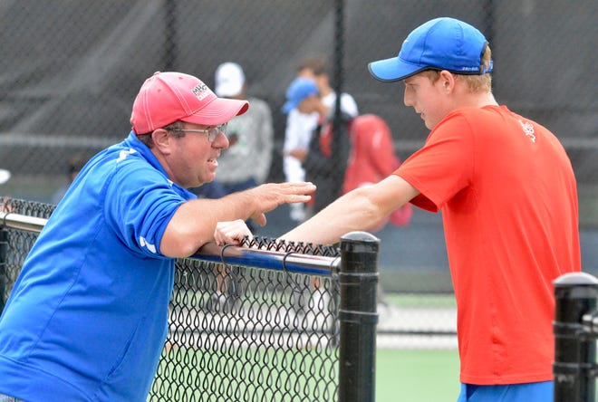 St. Clair boys tennis player Eli Pinnoo consults with coach Dave Clutts during the Division 3 regional on Friday, Oct. 11, 2019.