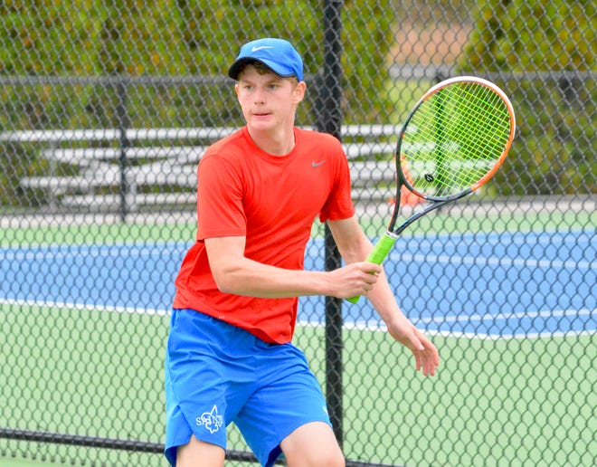 St. Clair boys tennis player Eli Pinnoo competes in the Division 3 regional on Friday, Oct. 11, 2019.