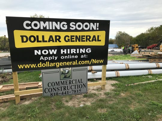 A construction crew works on the site of a new Dollar General at 1251 Water St. in Port Huron on Oct. 11, 2019.