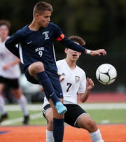From left,  Briarcliff's Matt Sturman (9) passes the ball in front of Valhalla's Dominick Novello (7) during boys soccer action at Briarcliff High School Oct. 10, 2019. Sturman scored the game winning goal in overtime to give the Bears a 1-0 victory.