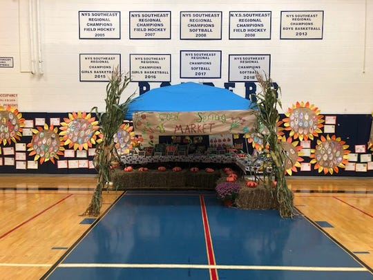 """A mini vegetable market is set up in the Stissing Mountain High School gymnasium for """"Ag Day"""" in Pine Plains."""