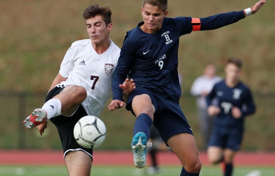 From left, Valhalla's Dominick Novello (7) and Briarcliff's Matt Sturman (9) battle for ball control during boys soccer action at Briarcliff High School Oct. 10, 2019. Sturman scored the game winning goal in overtime to give the Bears a 1-0 victory.