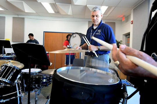 West York High School music teacher Rod Meckley, center, works with students, from left, Matthew Nguyen, Marcus Ropp and Colby Whetstone during the Lunch and Learn program Friday, Oct. 11, 2019. The program allows students time during the school hours for lunch and participation in various school activities of their choosing. Bill Kalina photo