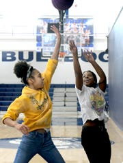West York High School sophomores Sariyah Gallon, left, and Akaia Lawrence play basketball during the Lunch and Learn program Friday, Oct. 11, 2019. The program allows students time during the school hours for lunch and participation in various school activities of their choosing. Bill Kalina photo