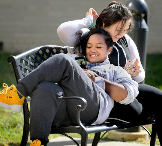 West York High School junior Rain Tapiador reclines on sophomore Aly Mattei during the Lunch and Learn program Friday, Oct. 11, 2019. The program allows students time during the school hours for lunch and participation in various school activities of their choosing. Bill Kalina photo