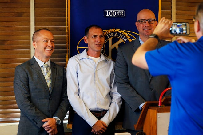 Mayor Dave Snow (from left) and his challengers Thomas Owens and Jamie Lopeman pose for a picture after an election forum during the Richmond Kiwanis Club meeting on Friday, Oct. 11, 2019.