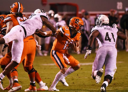 North Carolina State Wolfpack defensive end Xavier Lyas (97) sacks Syracuse Orange quarterback Tommy DeVito (13) during the second half at Carter-Finley Stadium. The Wolfpack won 16-10.