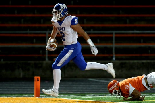 McNary's Junior Walling (2) rushes in for a touchdown past Sprague's Nico Fox (37) in the McNary vs. Sprague football game at Sprague High School in Salem on Oct. 10, 2019. McNary won the game 51-18.
