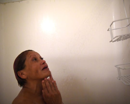 Maria Morales, who lives on the streets of Chinatown, showers at Dorothy's Place. Oct. 11, 2019.