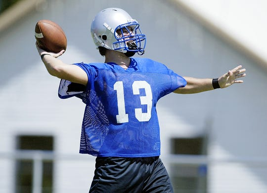 Tyler Ethridge prepares to throw a pass during a Richland Springs football practice.