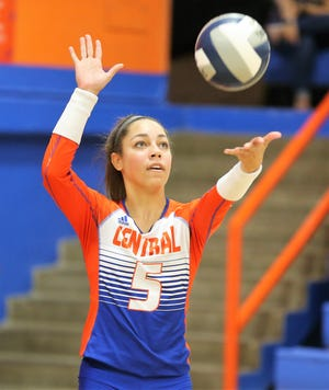 San Angelo Central High School's Mya Moore gets ready to serve against Fort Haltom at Babe Didrikson Gym on Tuesday, Oct. 8, 2019.