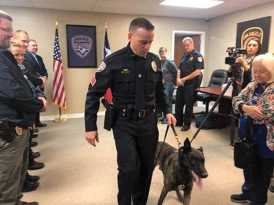 K-9 Thor is led out by his partner Brian Gesch after his retirement ceremony Friday, Oct. 11, 2019.