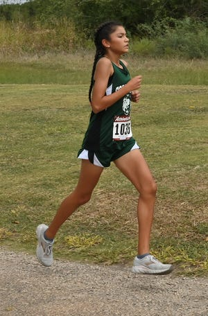 Cornerstone Christian's School's Lesli Salas runs to a first-place finish in the girls division at the Sonora Cross Country Monday, Sept. 7, 2019 at the Sonora Golf Course.