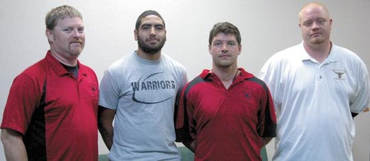 Tyler Ethridge (second from right) is shown with the football coaching staff at Victory Life Academy in Brownwood in 2013.