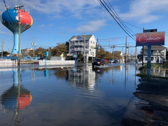 A vehicle navigates flooded Baltimore Avenue in Ocean City on Friday morning, Oct. 11. Parts of Ocean City and other coastal areas on Delmarva were hit hard by flooding with more forecast through the weekend.