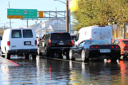 Coastal flooding Friday morning covered downtown Ocean City streets in water making travel difficult.