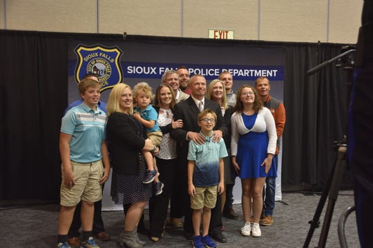 Det. Tim Bakke and his family pose for a picture after Bakke was honored at a retirement ceremony Friday, Oct. 11, for his 24 years with the Sioux Falls Police Department.