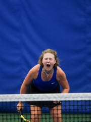 St. Thomas More's Bridget Raymond celebrates a win after in an intense match against Lincoln's Ava Leonard during the state championship tournament on Friday, Oct. 11, 2019.